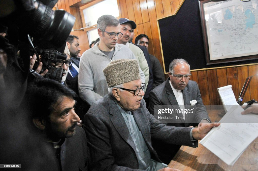 National Conference Patron and President Farooq Abdullah filling his nomination paper for parliamentary elections on March 20, 2017 in Srinagar, India. He was accompanied by former Chief Minister Omar Abdullah and President of Jammu and Kashmir Pradesh Congress (JKPC) Ghulam Ahmad Mir and Congress leader Tariq Hamid Karra.