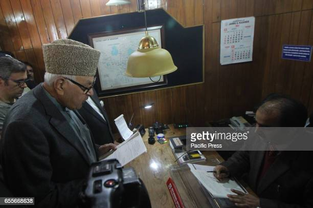 National conference president Dr Farooq Abdullah Congress Srinagar candidate for parliament bypolls signs on the nomination paper in Srinagar in...
