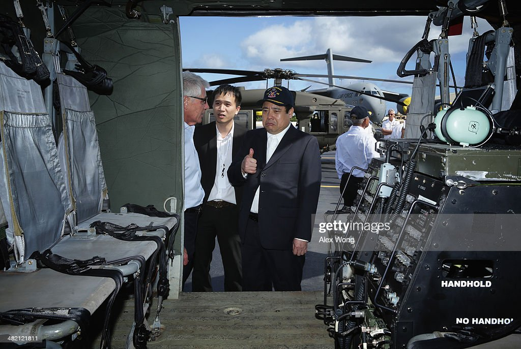 National Defense Minister of Vietnam General Phung Quang Thanh (R) gives a thumbs up as he looks at the interior of a Black Hawk helicopter with U.S. Secretary of Defense <a gi-track='captionPersonalityLinkClicked' href=/galleries/search?phrase=Chuck+Hagel&family=editorial&specificpeople=504963 ng-click='$event.stopPropagation()'>Chuck Hagel</a> during a tour April 2, 2014 at Hickam Air Force Base in Honolulu, Hawaii. Secretary Hagel is in Hawaii to host a meeting of defense ministers from the Association of Southeast Asian Nations (ASEAN) on April 1 to 3.