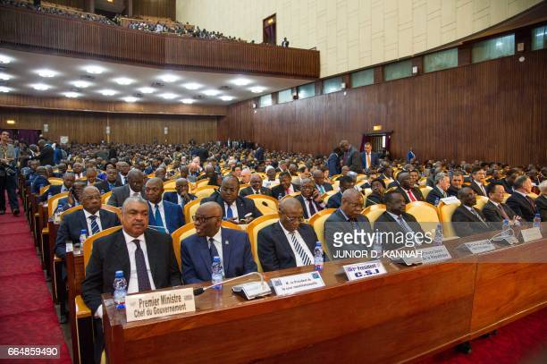 National deputies senators diplomatic corps and other guests gather to listen to the speech of the Congolese president at the Palace of the People in...