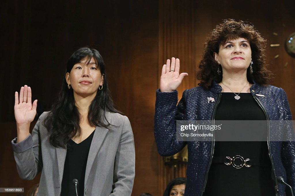 National Domestic Workers Alliance Director Ai-jen Poo (L) and Tufts University Electrical and Computer Engineering Professor Karen Panetta are sworn-in before testifying to the Senate Judiciary Committee March 18, 2013 in Washington, DC. The committee heard testimony about immigration reform in regards to women and families during the hearing, titled 'How Comprehensive Immigration Reform Should Address the Needs of Women and Families.'