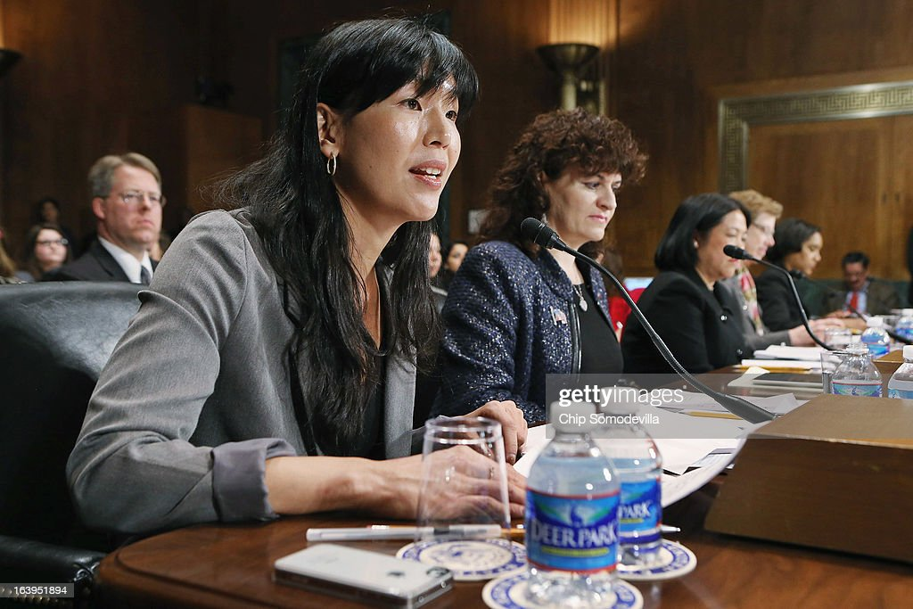 National Domestic Workers Alliance Director Ai-jen Poo, Tufts University Electrical and Computer Engineering Professor Karen Panetta, Asian American Justice Center President and CEO Mee Moua, Georgetown University International Migration Professor Susan Martin, National Council of La Raza's Health and Civil Rights Policy Project Director Jennifer Ng'andu testify before the Senate Judiciary Committee March 18, 2013 in Washington, DC. The committee heard testimony about immigration reform in regards to women and families during the hearing titled 'How Comprehensive Immigration Reform Should Address the Needs of Women and Families.'