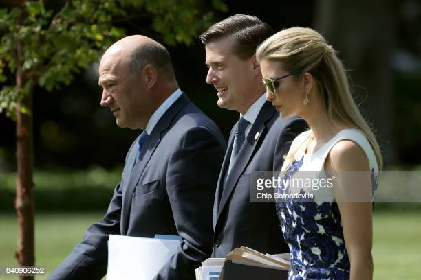 National Economic Council Director Gary Cohn White House Staff Secretary Rob Porter and Ivanka Trump walk across the South Lawn before departing the...