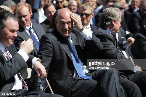 National Economic Council Director Gary Cohn wipes away sweat while waiting for President Donald Trump announce his decision for the United States to...