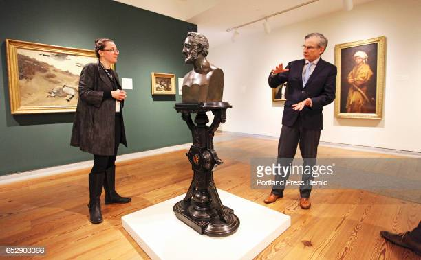 National Endowment for the Humanities chairman William 'Bro' Adams right discusses a sculpture pedestal of Dr John Mofatt while visiting the Friedman...