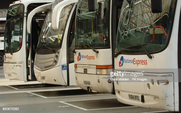 National Express coaches stand parked in a row in Victoria coach station London