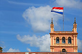 National flag flying above Presidential Palace in Asuncion, Paraguay. It serves as a workplace for the President and the government of Paraguay.