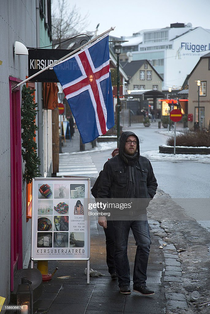 A national flag hangs above the entrance to a tourist store in Reykjavik, Iceland, on Wednesday, Jan. 2, 2013. Iceland's inflation rate eased in December as central bank efforts to stabilize the krona with interest rate increases paid off. Photographer: Arnaldur Halldorsson/Bloomberg via Getty Images