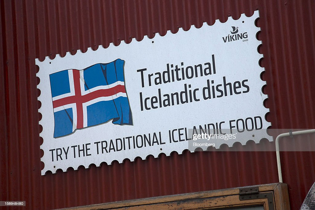 A national flag is seen on an advertisement for traditional Icelandic food in Reykjavik, Iceland, on Wednesday, Jan. 2, 2013. Creditors of Iceland's three biggest failed banks are fighting for a waiver to krona controls imposed in 2008 amid risks pay-outs will be delayed beyond 2015. Photographer: Arnaldur Halldorsson/Bloomberg via Getty Images