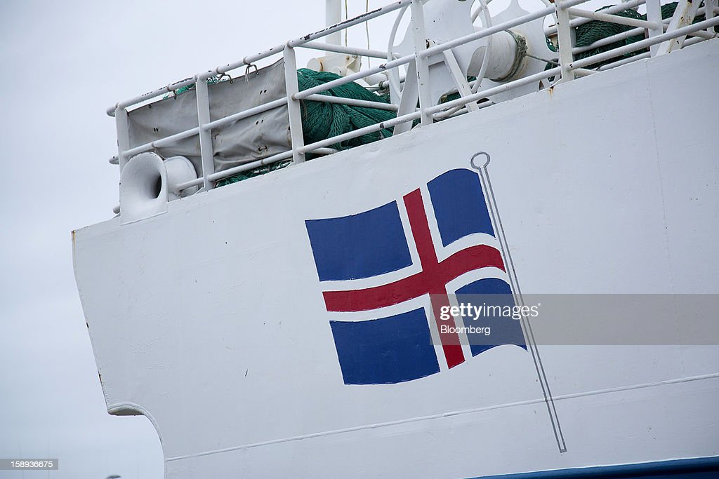 A national flag is seen on the hull of a commercial fishing vessel at the harbour in Reykjavik, Iceland, on Wednesday, Jan. 2, 2013. Iceland's inflation rate eased in December as central bank efforts to stabilize the krona with interest rate increases paid off. Photographer: Arnaldur Halldorsson/Bloomberg via Getty Images