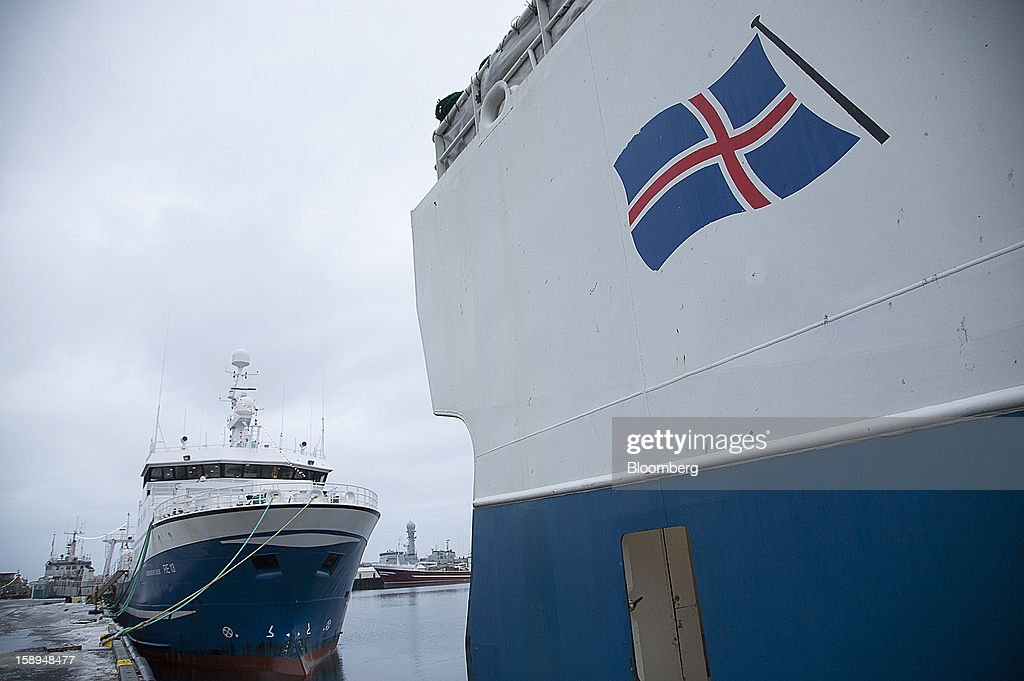 A national flag is seen on the hull of a commercial fishing vessel moored in the harbor in Reykjavik, Iceland, on Wednesday, Jan. 2, 2013. Creditors of Iceland's three biggest failed banks are fighting for a waiver to krona controls imposed in 2008 amid risks pay-outs will be delayed beyond 2015. Photographer: Arnaldur Halldorsson/Bloomberg via Getty Images