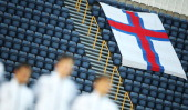 A national flag of Faroe Islands is displayed during the nationoal anthems prior to the UEFA Under21 Euro 2015 Qualifier match between Faroe Islands...