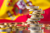 National flag of spain and euro coins - concept. Euro coins. Euro money. Euro currency.