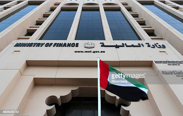 A national flag of the UAE flies outside the nation's Ministry of Finance headquarters in the Al Ghubaiba creek district of Dubai United Arab...