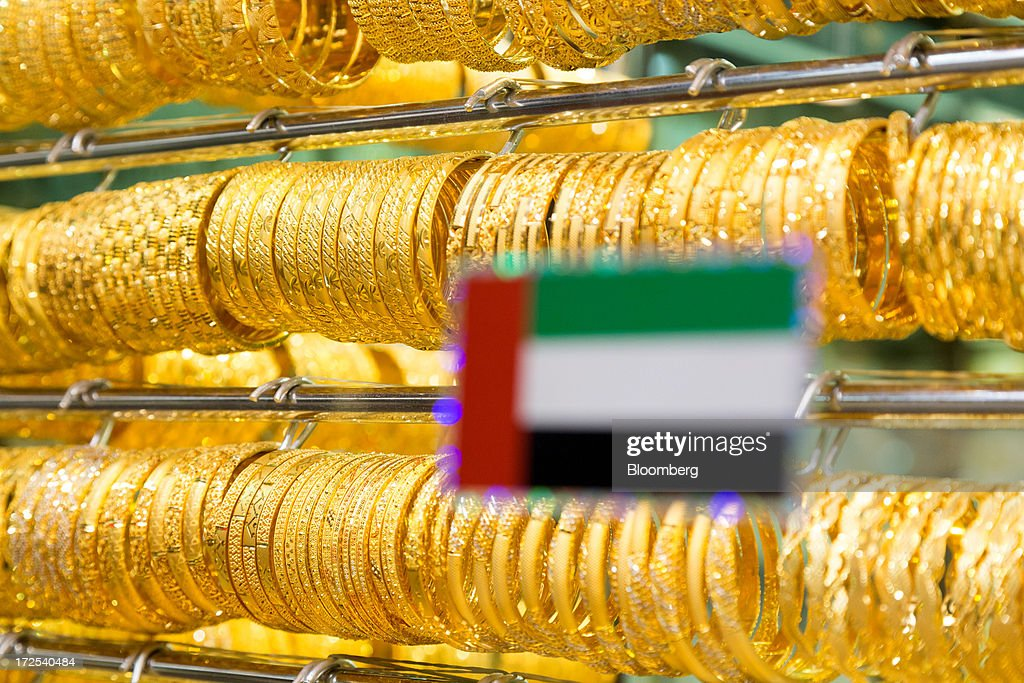 A national flag of the United Arab Emirates sits on the window of a gold jewelry store in the Dubai Gold Souk in the Deira district of Dubai, United Arab Emirates, on Tuesday, July 2, 2013. Gold swung between gains and losses in London as investors weighed prospects for increased physical demand against a slowing stimulus in the U.S. Photographer: Duncan Chard/Bloomberg via Getty Images