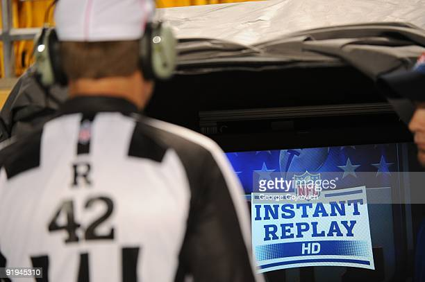National Football League referee Jeff Triplette looks at the instant replay monitor to review a challenged play during a game between the San Diego...