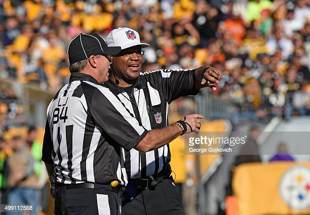 National Football League referee Ronald Torbert talks with line judge Mark Steinkerchner during a game between the Cleveland Browns and Pittsburgh...