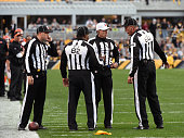 National Football League referee Tony Corrente confers with side judge Bart Longson field judge Buddy Horton and umpire Dan Ferrell during a game...