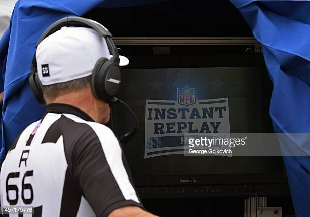 National Football League referee Walt Anderson looks at the monitor in the instant replay booth used to review challenged plays during a game between...