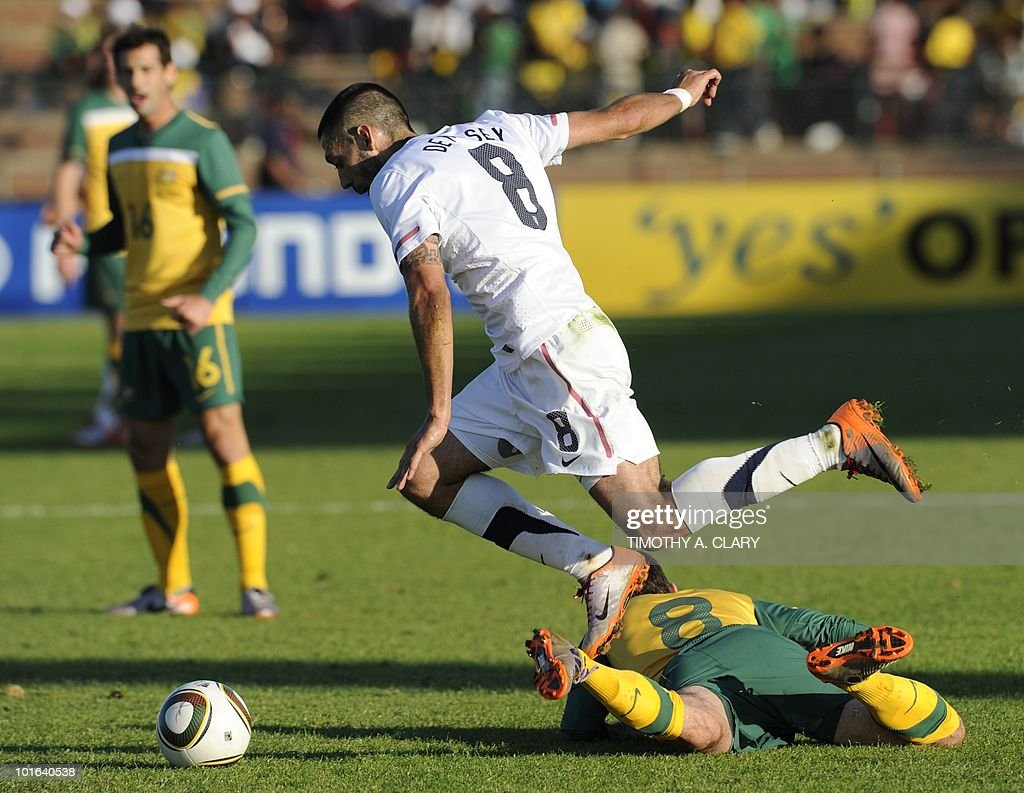 US national football team player Clinton Dempsey (C) jumps over Autralian national team player Luke Wilkshire (R) during a friendly match at the Ruimsig Stadium in Johannesburg on June 5, 2010. The US team is preparing for the 2010 FIFA World Cup in South Africa. The United States beat Australia 3-1.