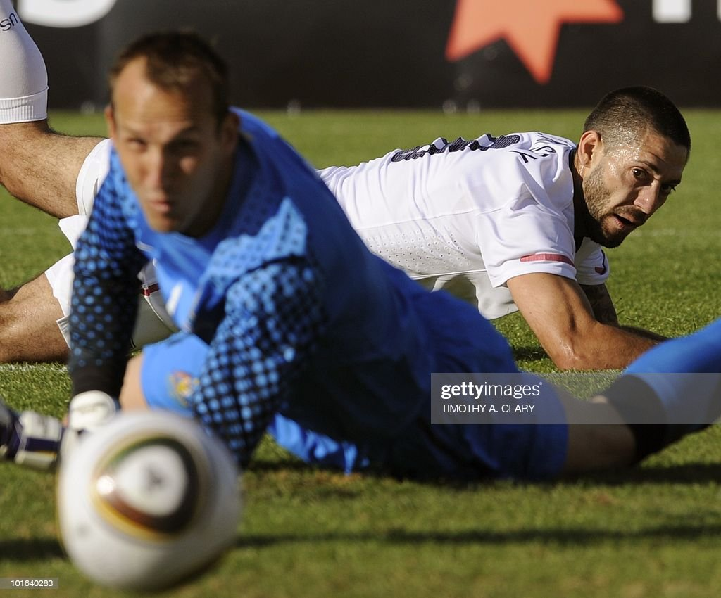 US national football team player Clinton Dempsey (R) lies on the ground after shooting against Australian goalkeeper Mark Schwarzer during a friendly match at the Ruimsig Stadium in Johannesburg on June 5, 2010. The US team is preparing for the 2010 FIFA World Cup in South Africa. The United States beat Australia 3-1.