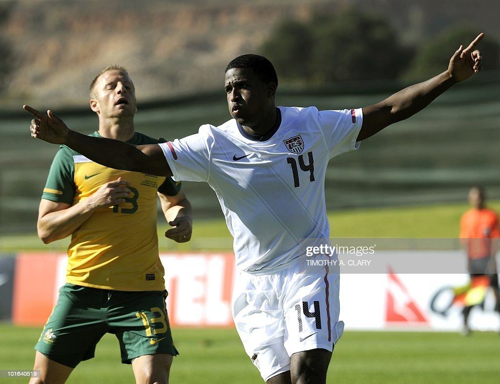 US national football team player Edson Buddle (R) celebrates after scoring the first goal against Australia in front of Australian Vincenzo Grella during a friendly match at the Ruimsig Stadium in Johannesburg on June 5, 2010. The US team is preparing for the 2010 FIFA World Cup in South Africa. The United States beat Australia 3-1.