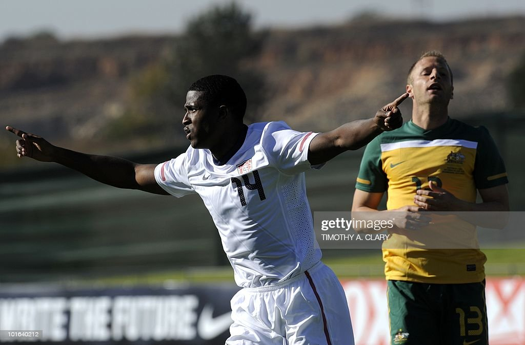 US national football team player Edson Buddle (L) celebrates the first goal as Australian Vincenzo Grella (R) reacts during a friendly match at the Ruimsig Stadium in Johannesburg on June 5, 2010. The US team is preparing for the 2010 FIFA World Cup in South Africa.