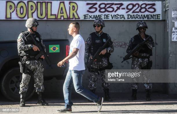 National Force officers patrol in the Chapadao favela community on May 15 2017 in Rio de Janeiro Brazil Hundreds of National Force officers have...