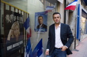 National Front candidate for local elections Laurent Lopez poses for a photograph outside his campaign's headquarters on October 9 in Brignoles south...
