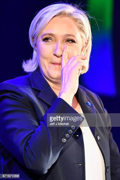 National Front leader Marine Le Pen addresses activists at the Espace Francios Mitterrand on April 23 2017 in Henin Beaumont France According to...