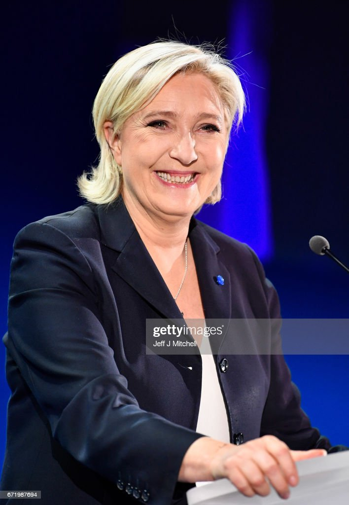 National Front leader Marine Le Pen addresses activists at the Espace Francios Mitterrand on April 23, 2017 in Henin Beaumont. According to projected results, founder and leader of the political movement 'En Marche !' Emmanuel Macron has received the most votes with National Front Party leader Marine Le Pen in second place, meaning both will now compete against each other in the next round of the French Presidential Elections on May 7.
