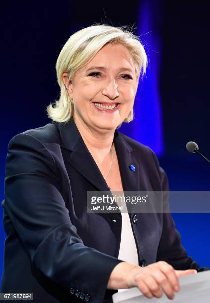 National Front leader Marine Le Pen addresses activists at the Espace Francios Mitterrand on April 23 2017 in Henin Beaumont According to projected...