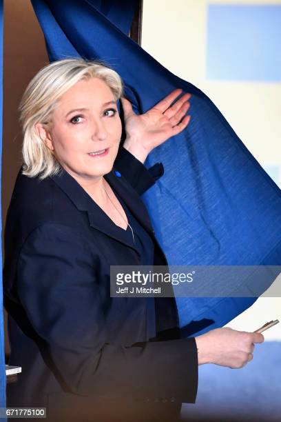 National Front Leader Marine Le Pen casts her vote for the French elections in a polling station on April 23 2017 in Henin Beaumont France French...