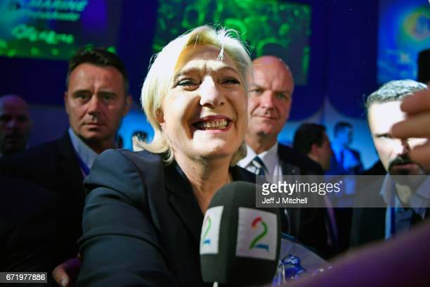 National Front leader Marine Le Pen greets supporters as she addresses activists at the Espace Francios Mitterrand on April 23 2017 in Henin Beaumont...