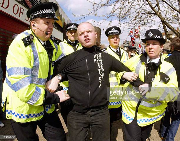 National Front member is arrested during a protest at the Finsbury Park Mosque as Muslim cleric Abu Hamza speaks to his followers only metres away 09...