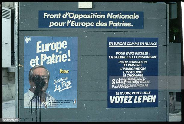 National Front posters promote the candidacy of JeanMarie Le Pen in a 1984 election Le Pen's face is obscured by black spray paint on the poster at...