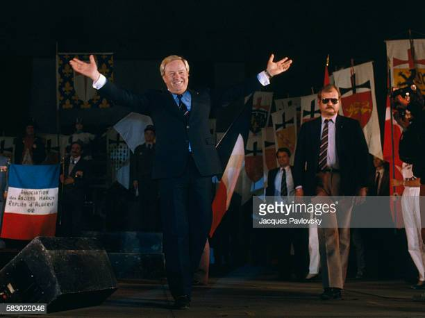 National Front President JeanMarie Le Pen walks on stage with arms outstretched during a political convention in Paris Le Pen who is also a member of...