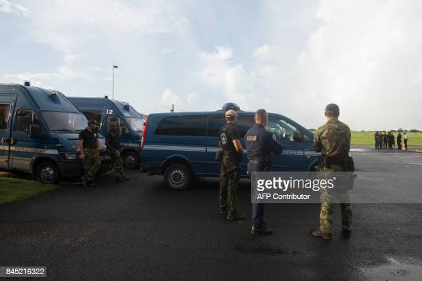 National Gendarmerie Intervention Group units of the French National Police wait on September 10 2017 to leave PointeaPitre International Airport in...