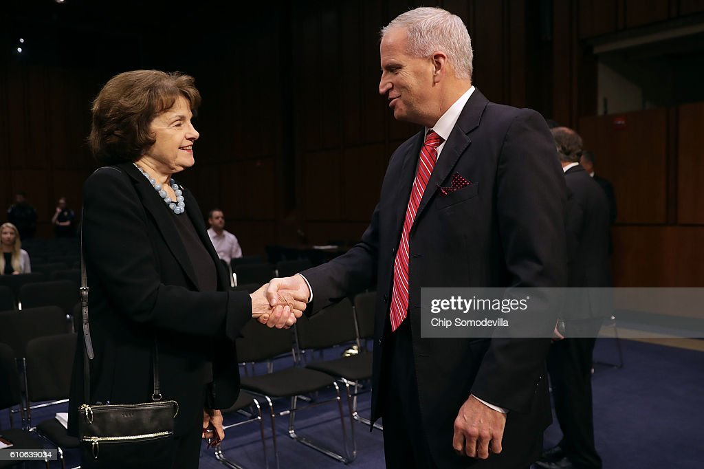 National Geospatial-Intelligence Agency Director Robert Cardillo (R) talks with Senate Select Committee on Intelligence ranking member Sen. Dianne Feinstein (D-CA) before testifying to the committee in the Hart Senate Office Building on Capitol Hill September 27, 2016 in Washington, DC. This was the first time in the agency's 20 years that the director testified in an open hearing.