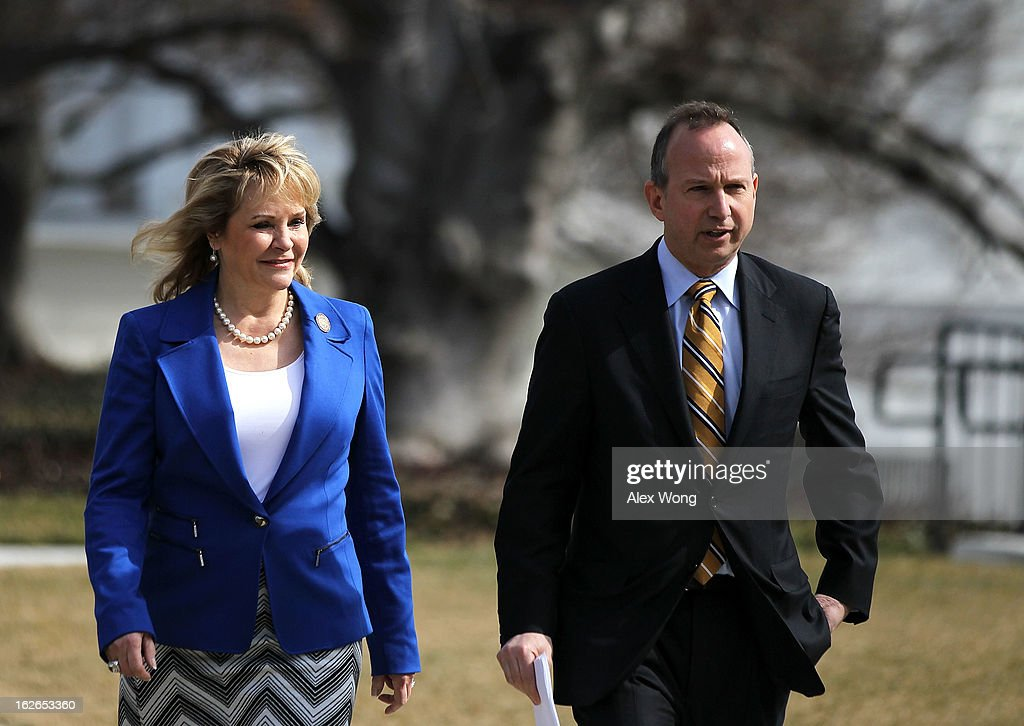 National Governors Association (NGA) Chair Delaware Gov. Jack Markell (R) and NGA Vice Chair Oklahoma Governor Mary Fallin (L) walk towards the microphones after a State Dining Room meeting with U.S. President Barack Obama at the White House February 25, 2013 in Washington, DC. Governors from across the nation were in Washington for the 2013 National Governors Association Winter Meeting.