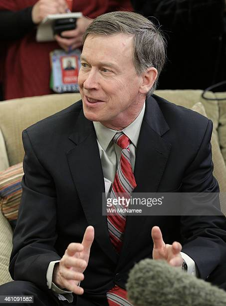 National Governors Association Chairman Gov John Hickenlooper speaks while meeting with US President Barack Obama in the Oval Office of the White...