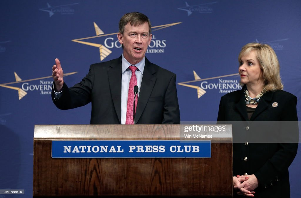 National Governors Association vice chairman Gov. <a gi-track='captionPersonalityLinkClicked' href=/galleries/search?phrase=John+Hickenlooper&family=editorial&specificpeople=4104050 ng-click='$event.stopPropagation()'>John Hickenlooper</a> (D-CO) (L) and National Governors Association chairwoman Gov. Mary Fallin (R-OK) (R) answer questions at the National Press Club January 15, 2014 in Washington, DC. Gov. Fallin and Gov. Hickenlooper delivered the annual 'State of the States' address prior to taking questions.