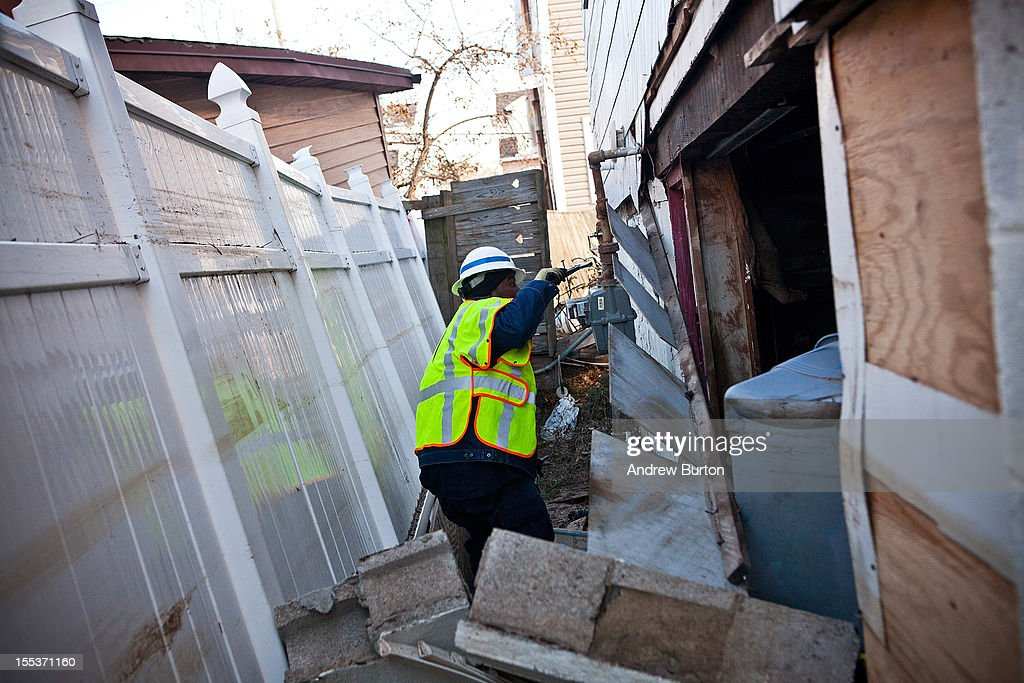 A National Grid employee checks for a turns off the gas in a home in the Midland Beach neighborhood of Staten Island on November 3, 2012 in New York City. As clean up efforts from Superstorm Sandy continue, colder weather and another storm predicted for next week are beginning to make some worried.