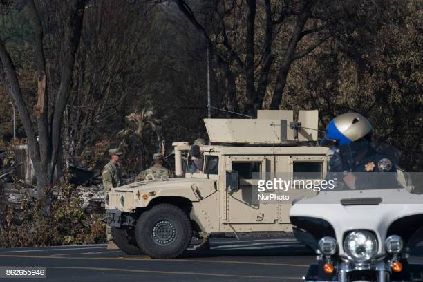 National Guard and local police are deployed to block access to area and neighborhood damaged during the recent devastating fire that hit Santa Rosa...
