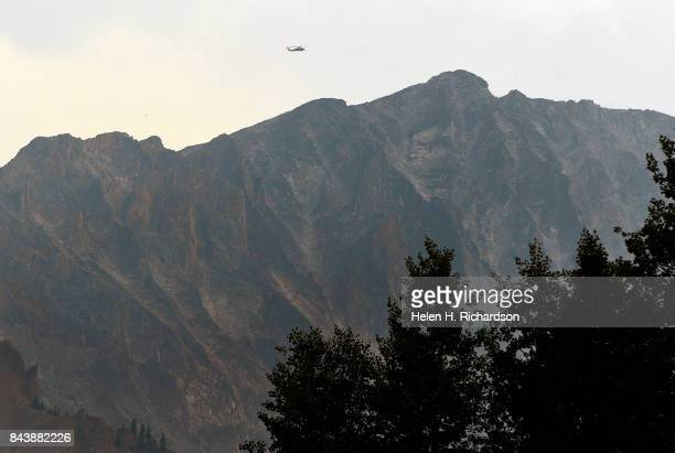 National Guard Black Hawk helicopter searches for a stranded climber near the K2 summit on Capitol Peak on September 6 2017 in the Maroon...