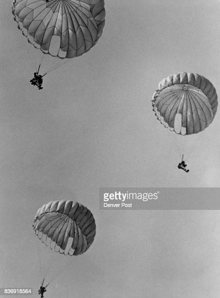 National Guard Colorado Coming Down For The 507th Three Parachutists float toward earth at Buckley Air National Guard Base after jumping from a...