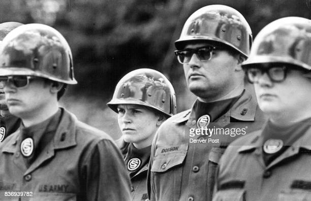 National Guard Colorado Standing in formation at rigid attention potential officers including Mrs Garrett at rear await inspection at the camp near...