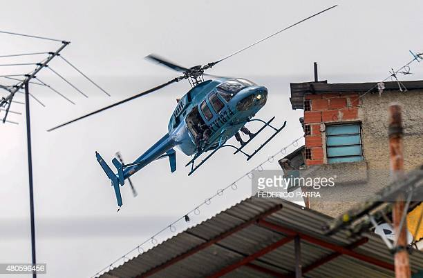 A National Guard helicopter takes part in a security operation at the Cota 905 neighborhood in Caracas on July 13 2015 Gangs which control the Cota...