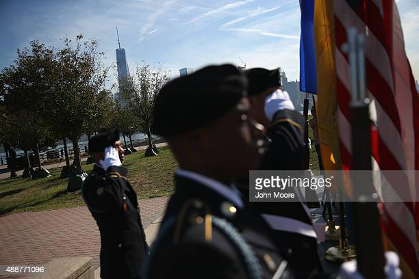 National Guard honor guard carries the colors as immigrants take part in a naturalization ceremony at Liberty State Park on September 17 2015 in...