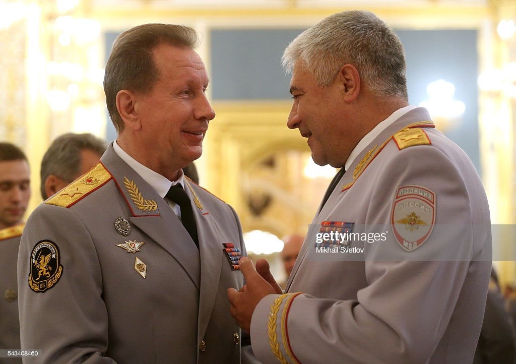 National Guard of Russia Commander-in-Chief Viktor Zolotov (L) listens to Interior Affairs Minister Vladimir Kolokoltsev (R) during the reception for graduates of military academies and universtities at the Grand Kremlin Palace on June 28, 2016 in Moscow, Russia.